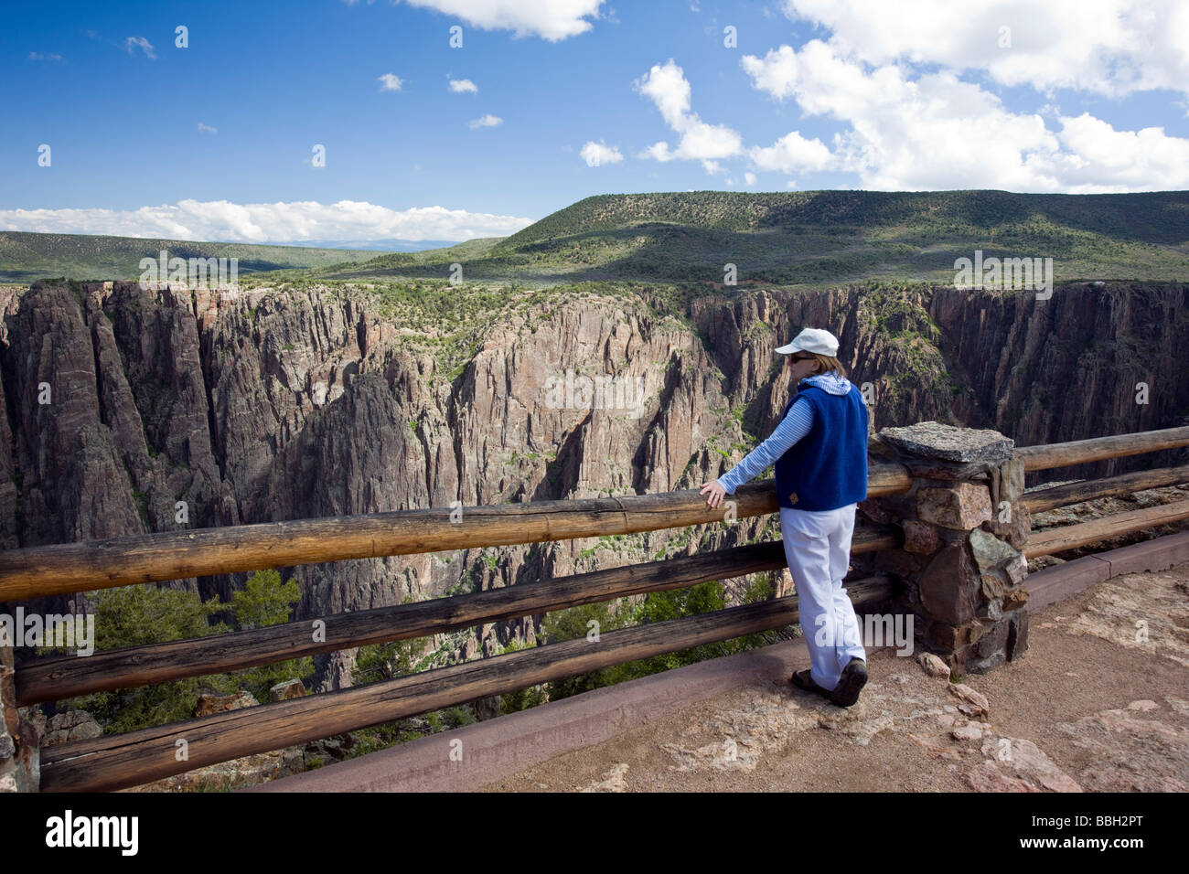 Female tourist at the Gunnison Point overlook near the Visitor Center Black Canyon of the Gunnison National Park - Stock Image