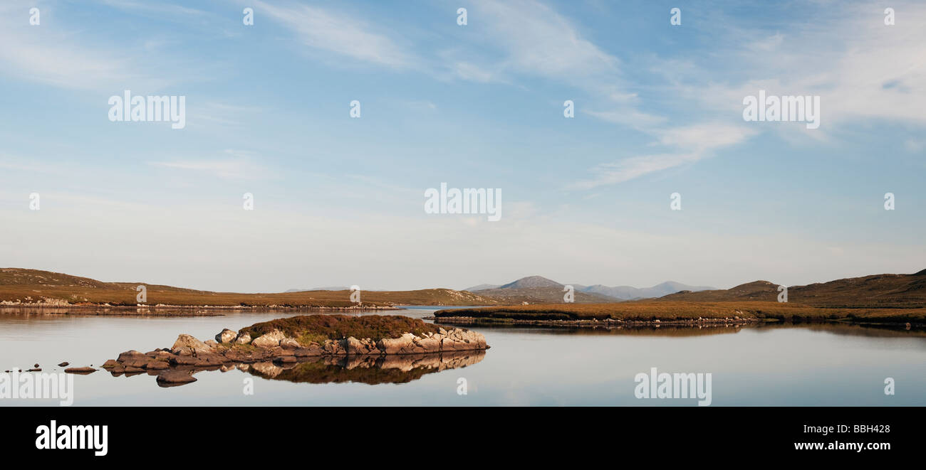 Evening light on a loch, Isle of Lewis, Outer Hebrides, Scotland. Panoramic - Stock Image