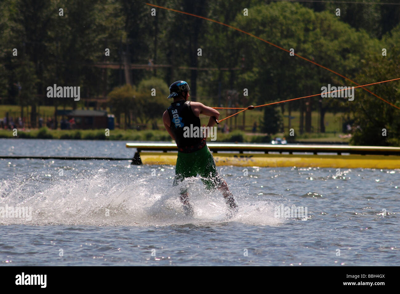 Water sports; wake boarding at Willen Lake in Milton Keynes in the summer. - Stock Image