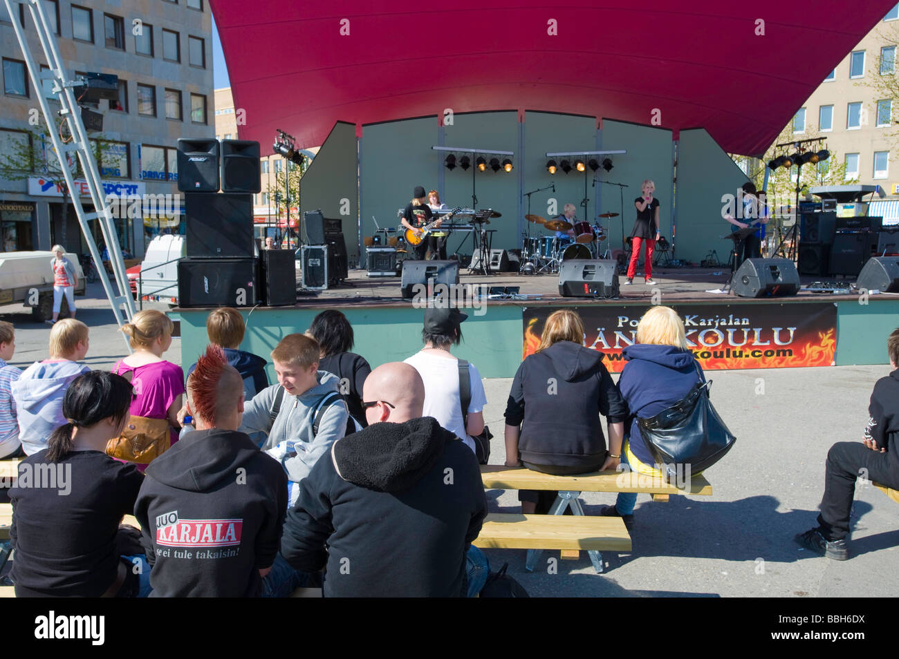 Teenage rock band performing on stage on Main Square Joensuu Karelia Finland - Stock Image