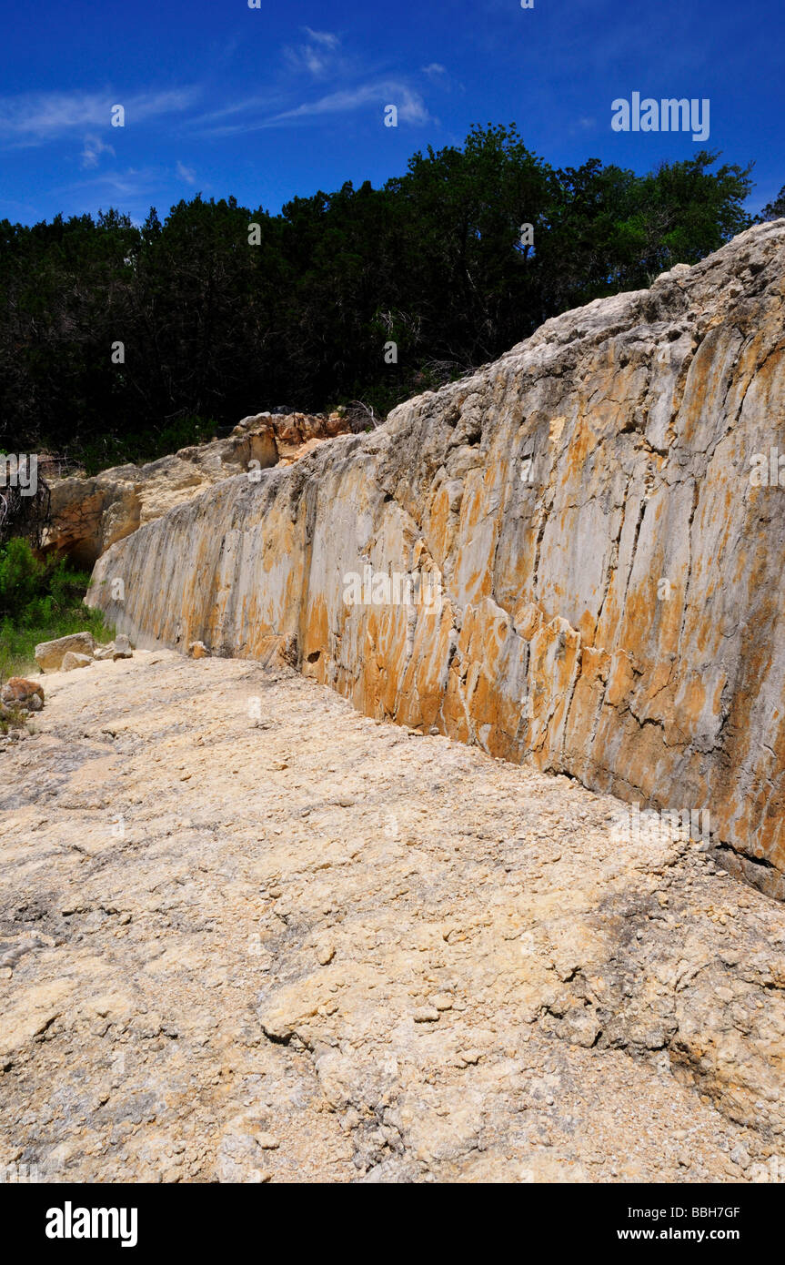 A freshly exposed fault scarp in limestone, Texas Hill Country, USA. - Stock Image