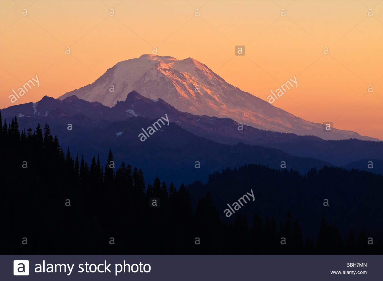 Mount Adams, Washington's second-tallest mountain, towers above neighboring peaks in this view from Chinook - Stock Image