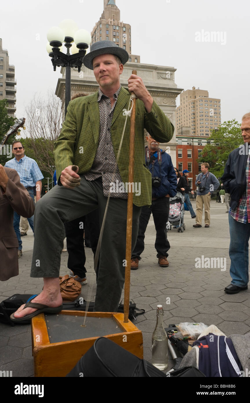 Peter Ford of the Baby Soda Jazz Band plays his one string bass at the official re-opening of Washington Square - Stock Image