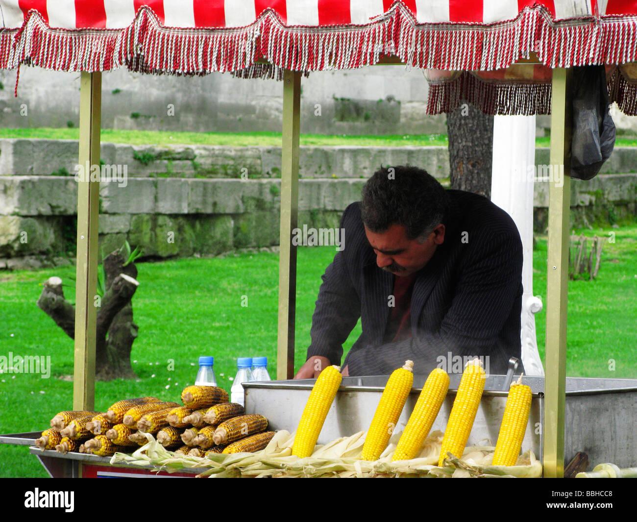 Street Vendor selling grilled Corn on the Cob Sultanahmet Istanbul Turkey - Stock Image