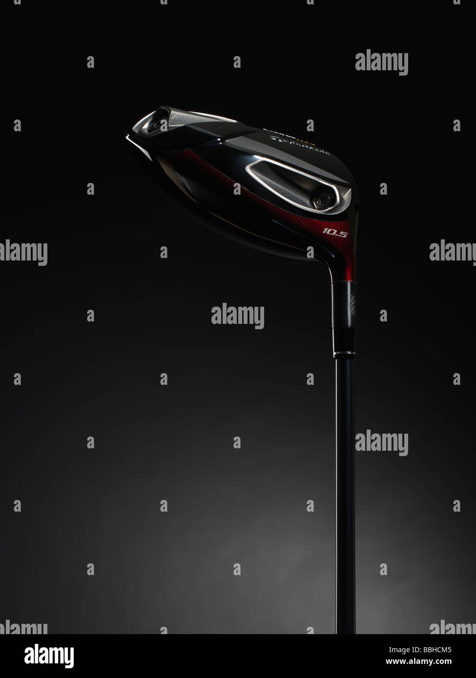 old style wooden golf clubs spotlit against a black background - Stock Image