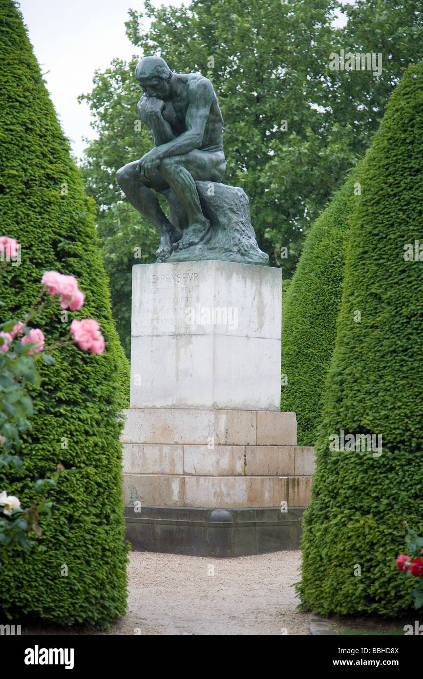The gardens of Musee Rodin and one of its better known sculptures The Thinker Paris France - Stock Image