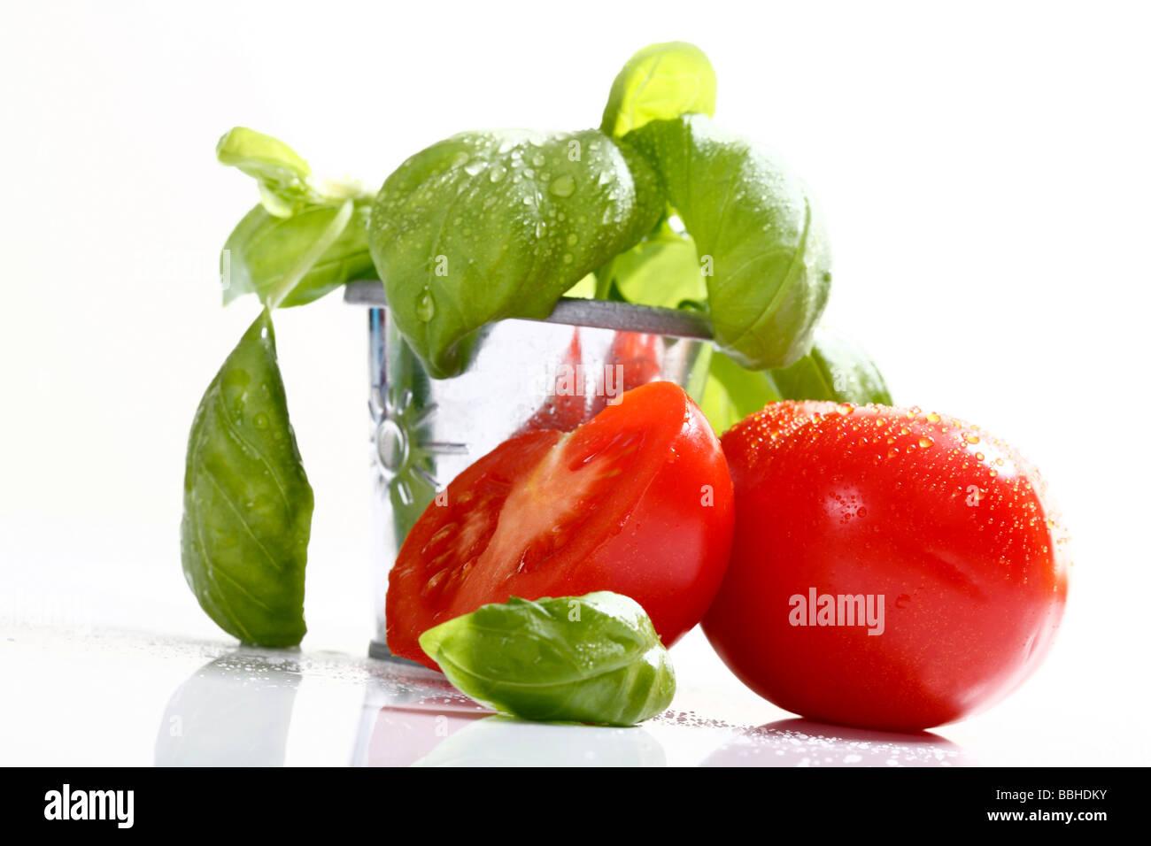 Tomatoes and basil Stock Photo