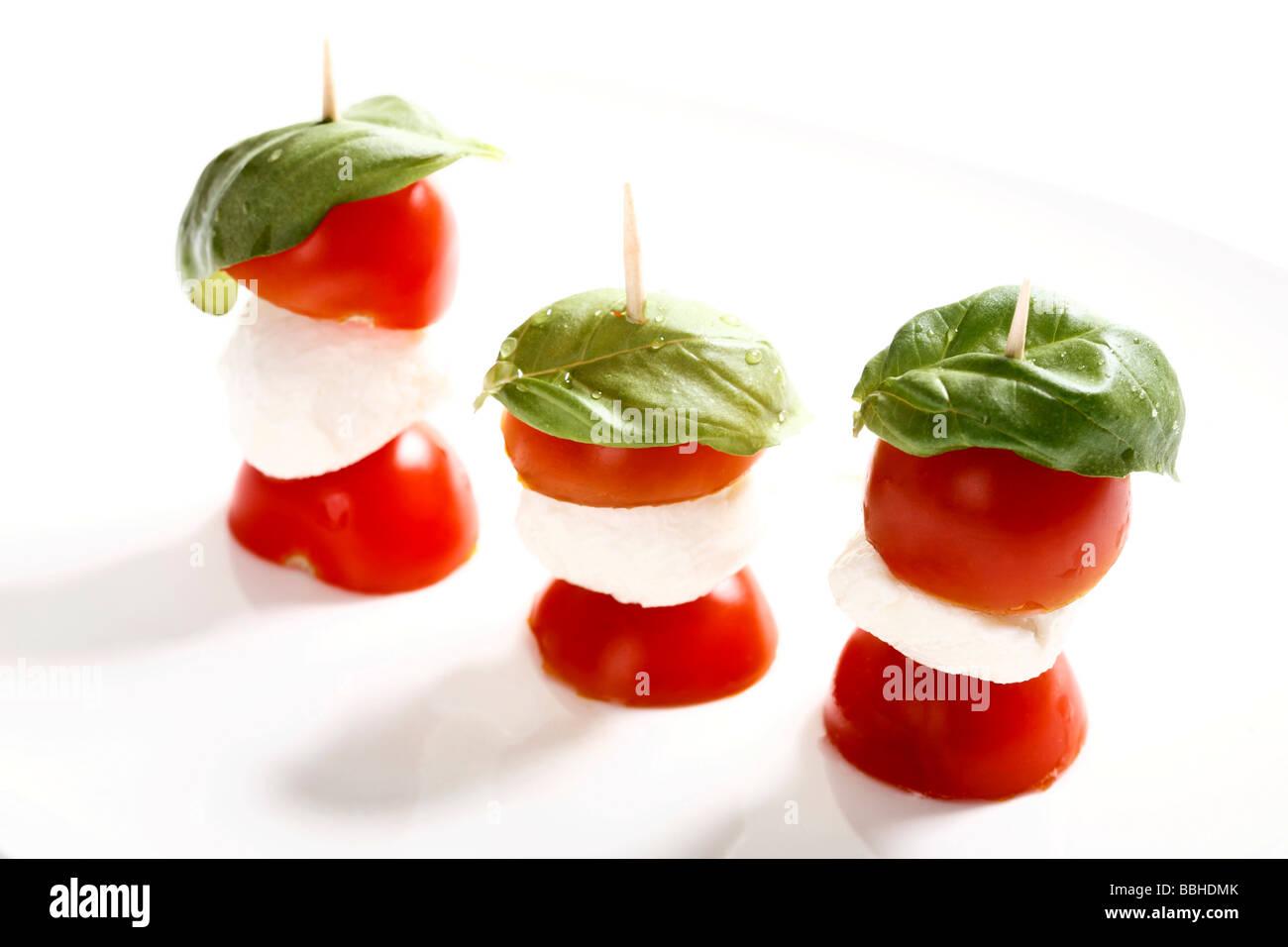 Tomato-mozzarella sticks with basil Stock Photo