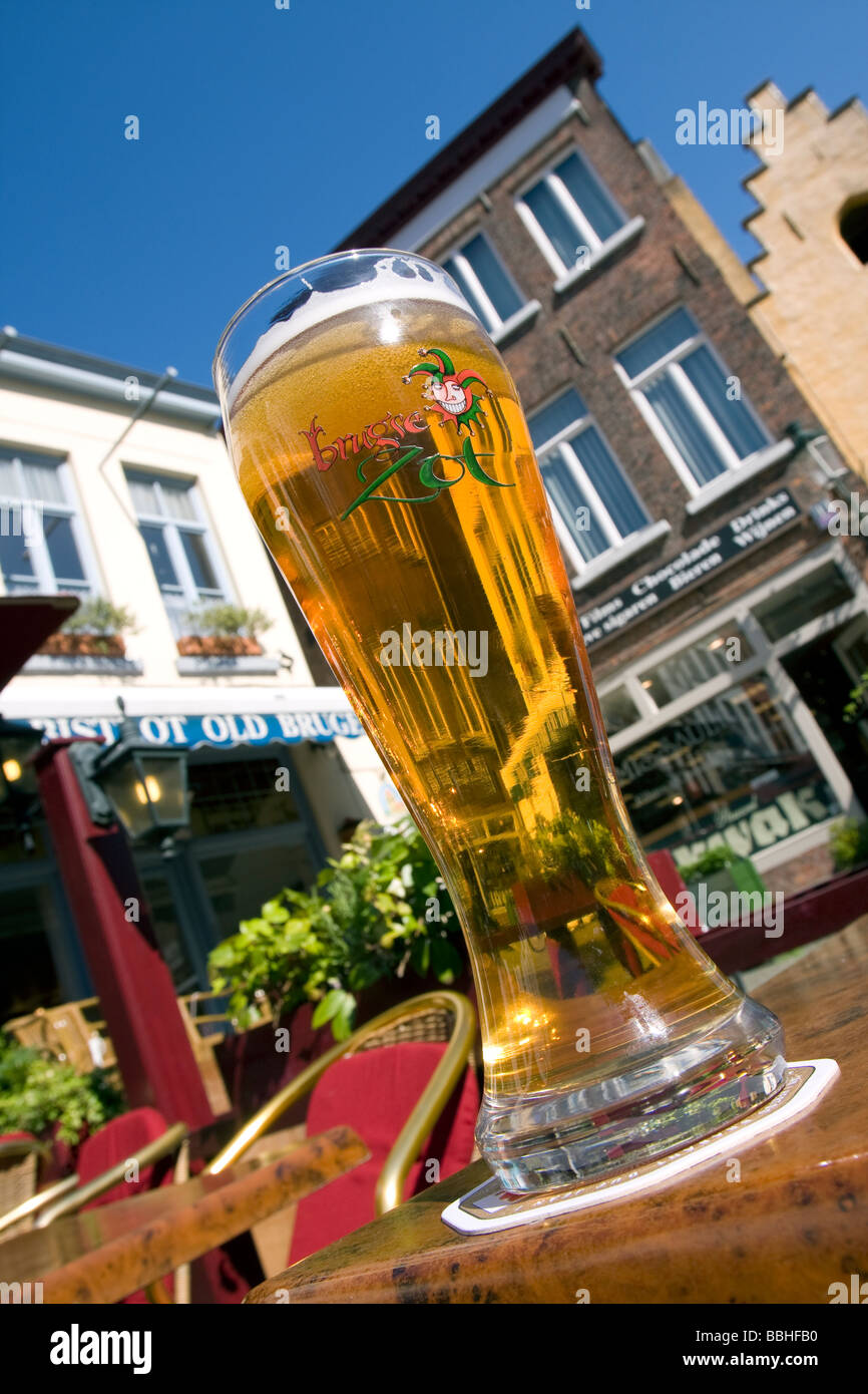 A cold glass og the local beer called Brugse Zot, during a sunny day, city trip bruges (brugge), Belgium Stock Photo