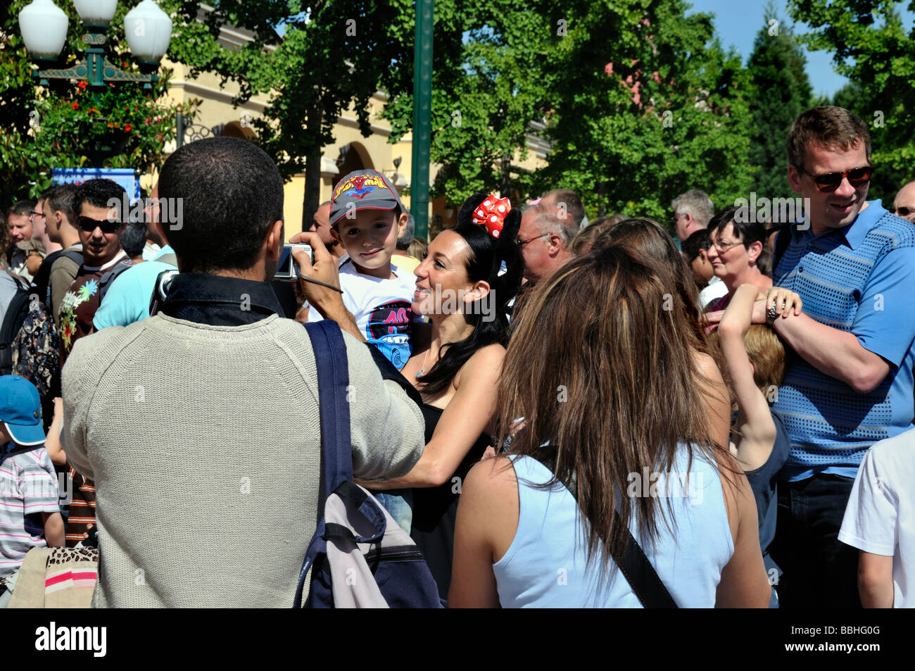 Paris France, Theme Parks, People Visiting Disneyland Paris Entrance, Father Taking Photos of Family Stock Photo
