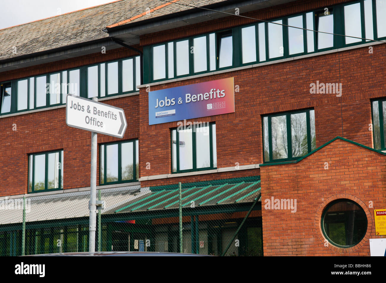 Road sign pointing to Jobs and Benefits Office in Antrim, Northern Ireland, UK - Stock Image