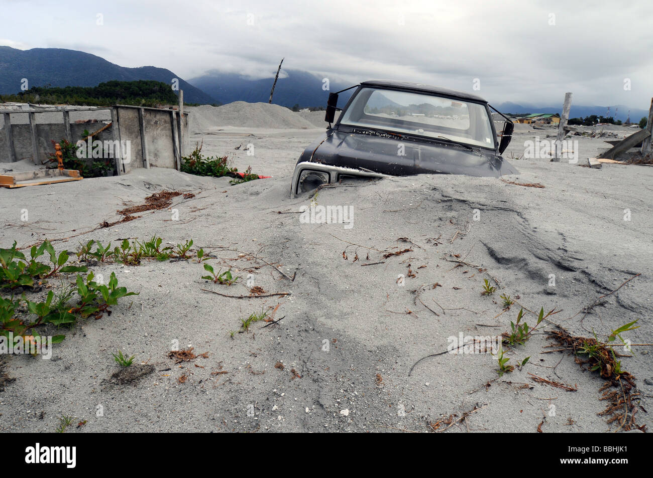 A buried car in the destroyed town of Chaiten after the volcanic eruption Stock Photo
