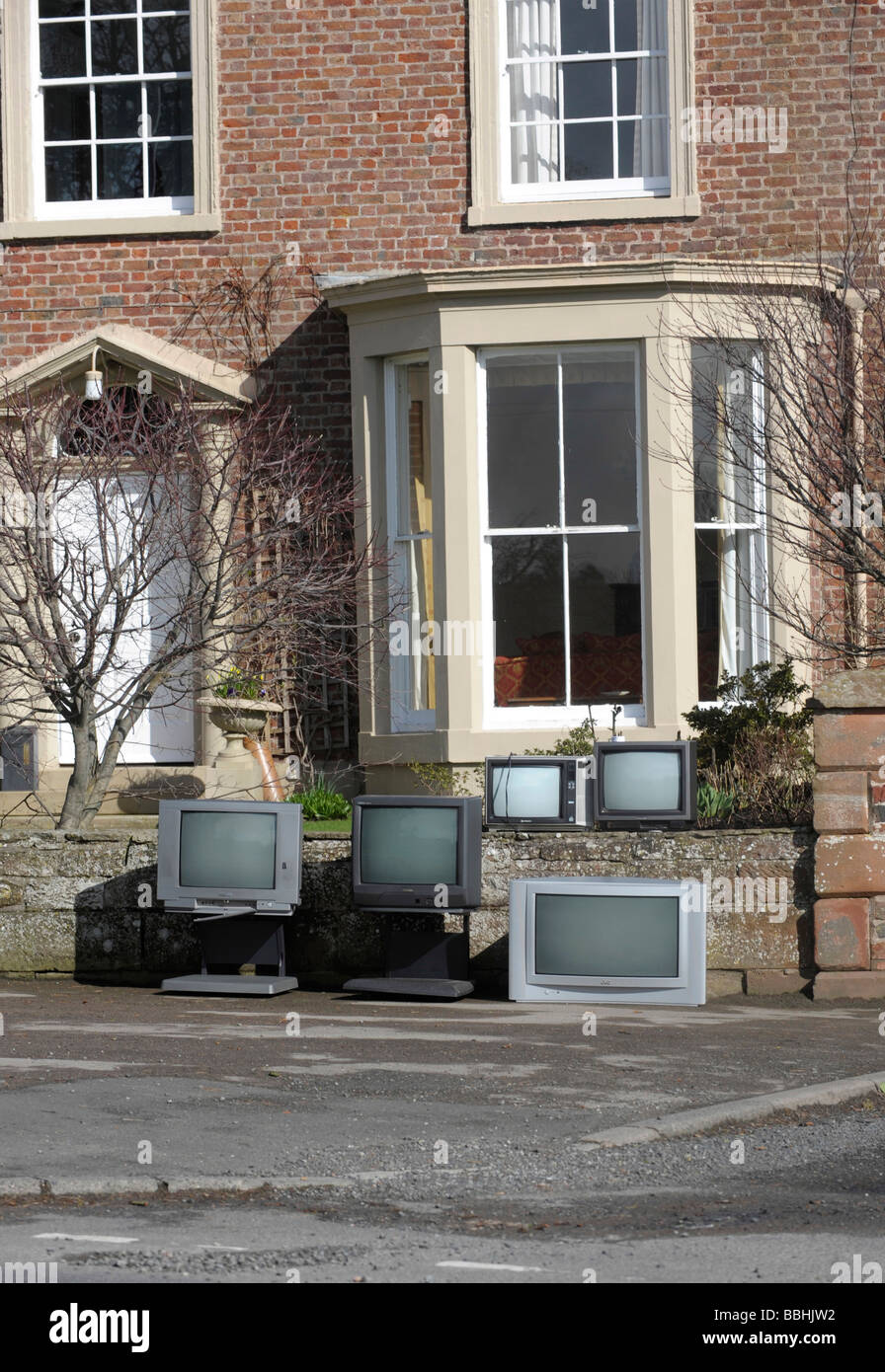 Old unwanted television TV sets not suitable after the digital switchover when analogue signal is switched off and - Stock Image