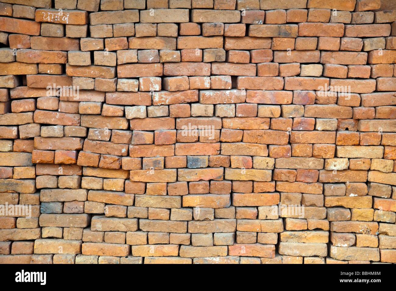 Precarious brick wall - Stock Image