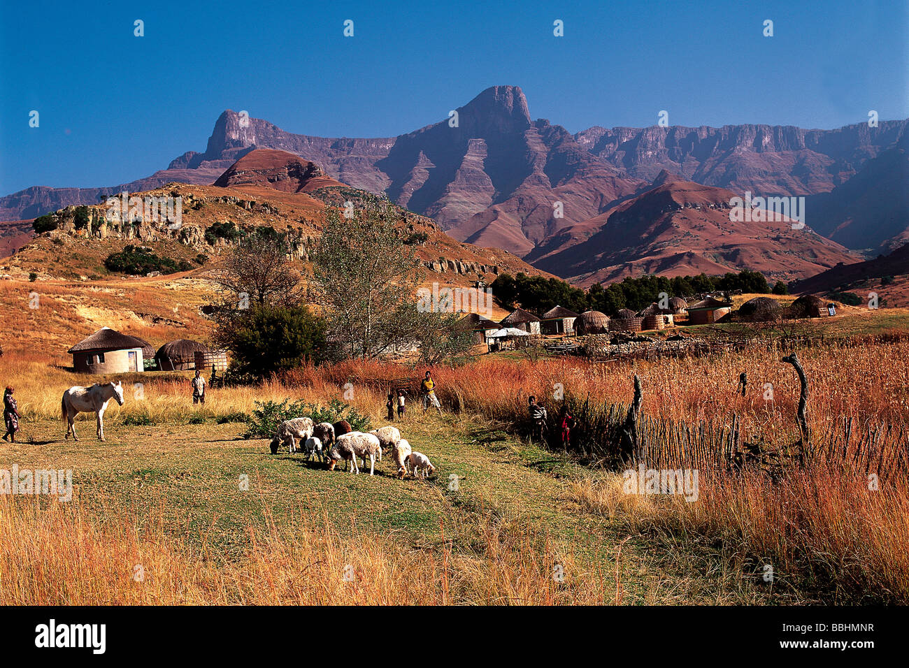 a rural scene against a mountain backdrop is typical of the