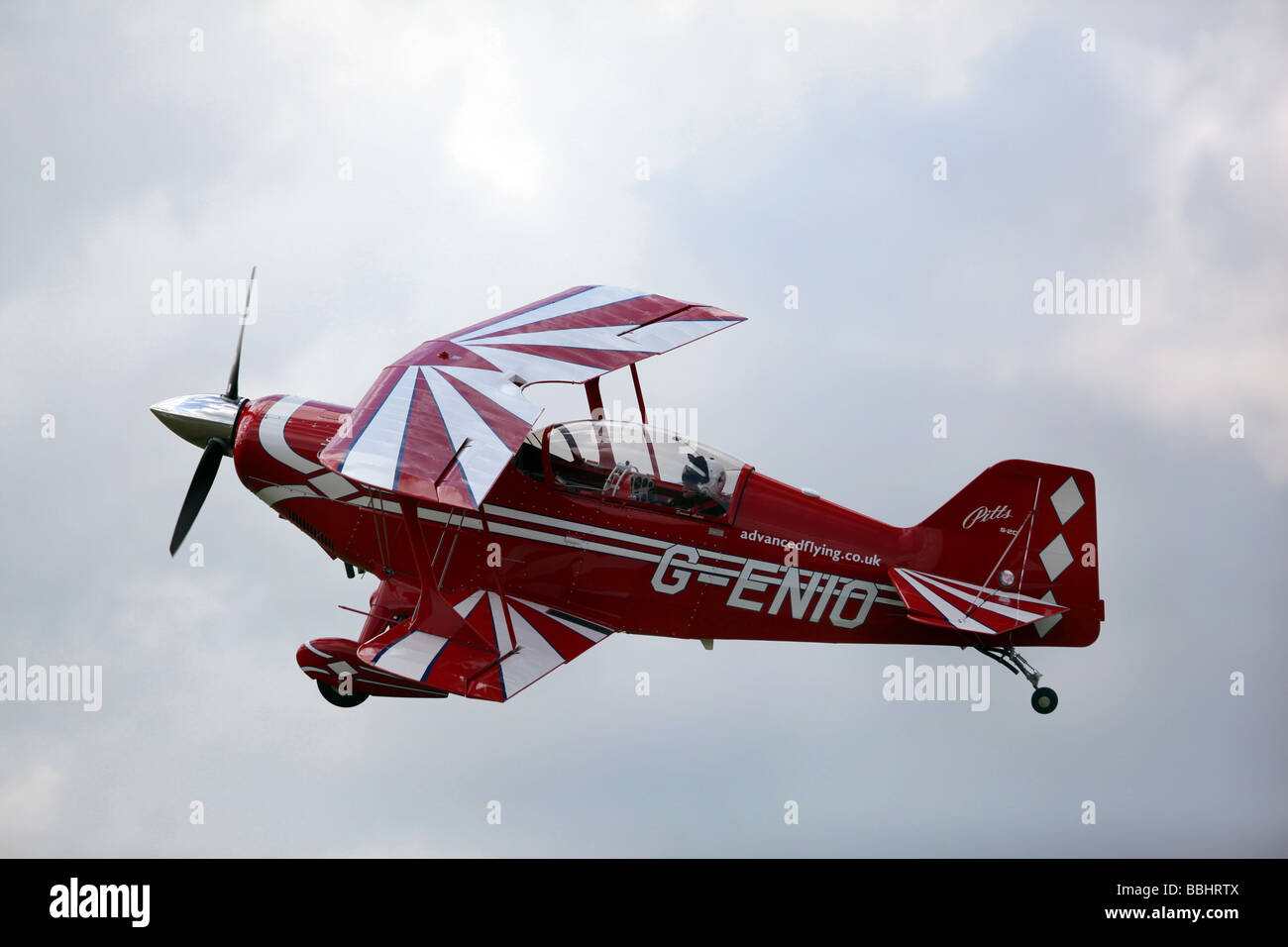 A  Pitts S2C Aviat bi plane flies in the sky above England, - Stock Image
