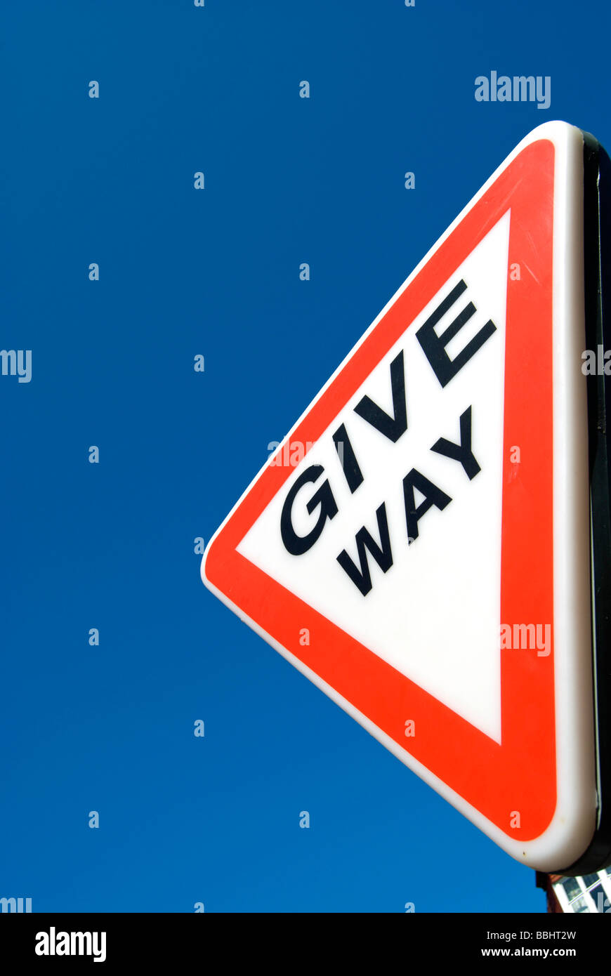 british traffic give way sign, seen against a blue sky Stock Photo