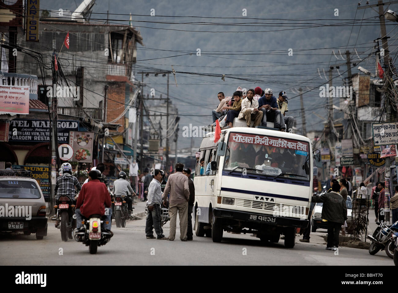Lakeside District, Pokhara, Nepal; Bus laden with people - Stock Image
