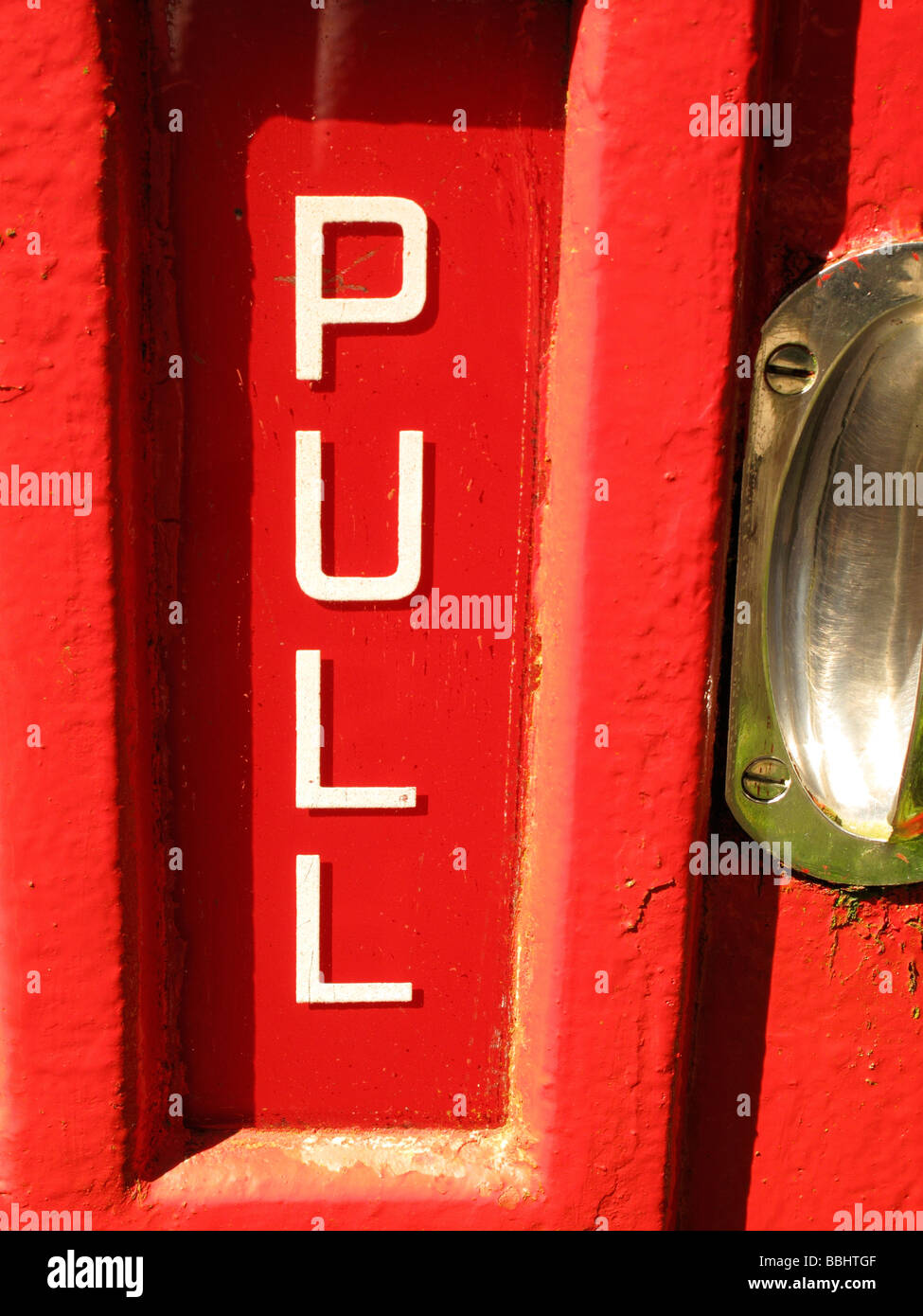 pull handle on telephone box - Stock Image