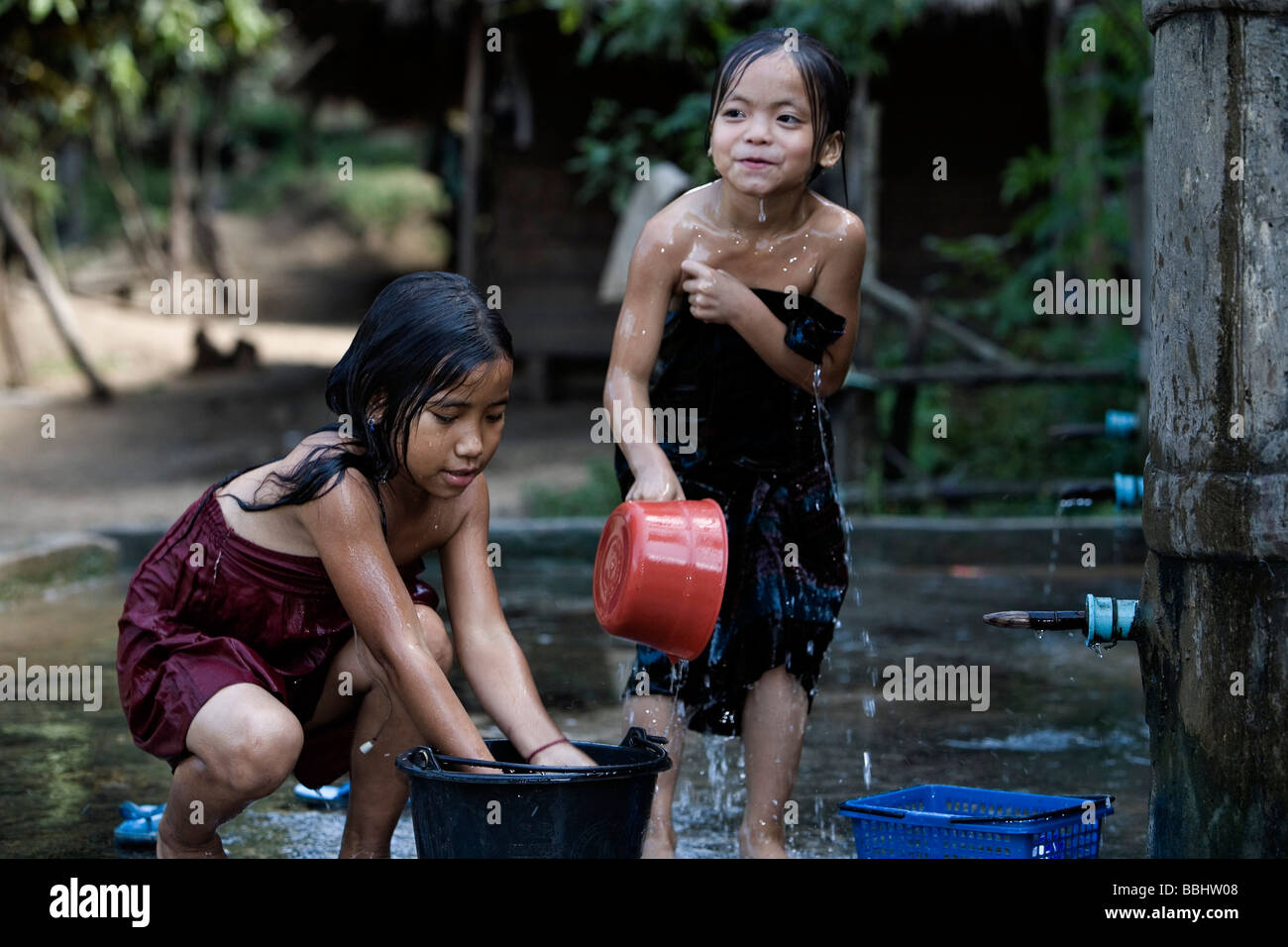 laos child girl bath Lao Children playing in the water, Next to Van Vieng, Laos ...