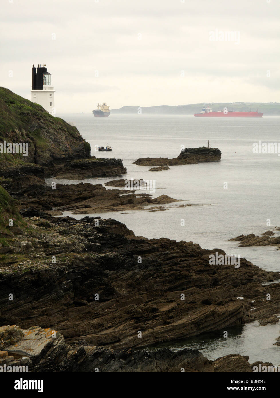 lighthouse sea and ships - Stock Image