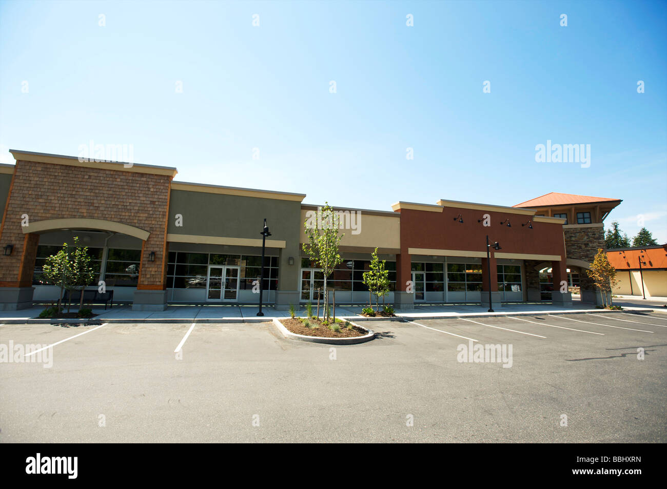 Empty store fronts in a suburban outdoor mall The economic crisis - Stock Image