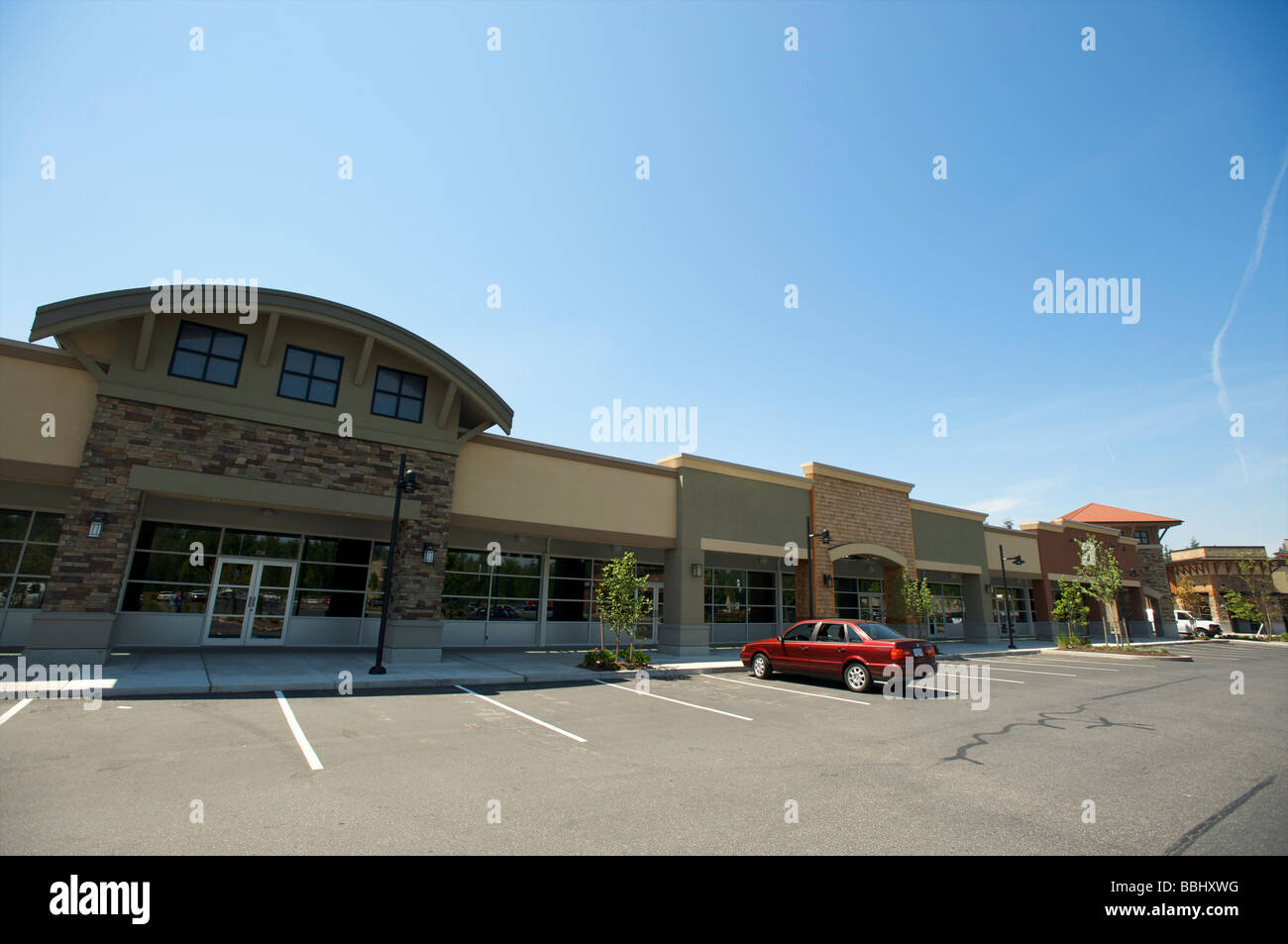 Empty store fronts in a suburban outdoor mall.  The economic crisis - Stock Image