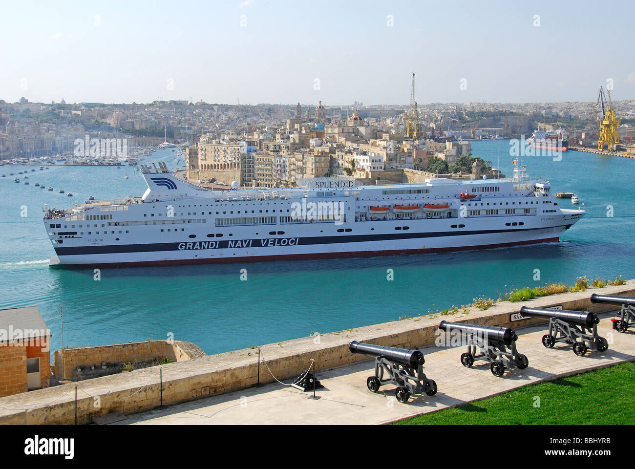 MALTA. A view from the Upper Barrakka Gardens in Valletta of a cruise ship passing Senglea on its way into the Grand - Stock Image