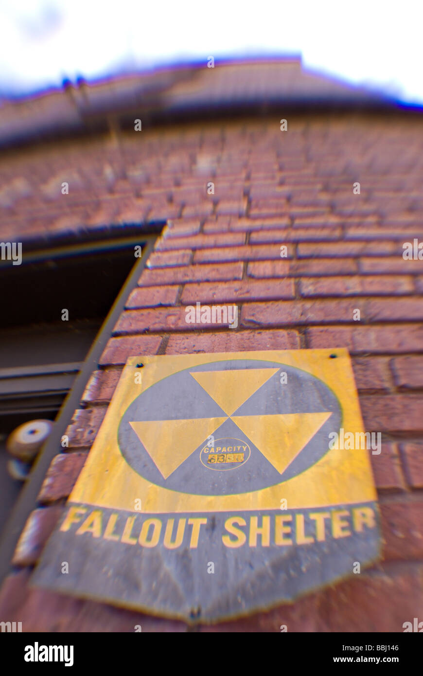 Nuclear war fallout shelter sign on an old worn out building in Dubuque, IA Stock Photo