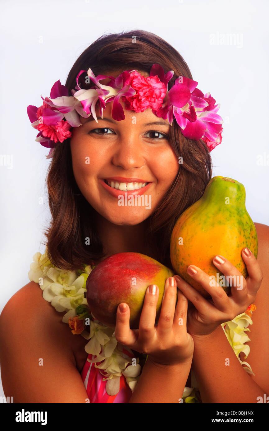 Portrait Of A Hawaiian Girl With Flower Lei Mango And Papaya Stock