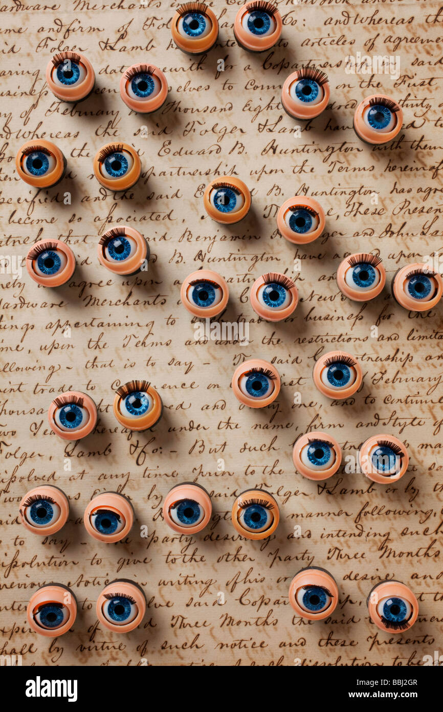 Doll eyes on old letter - Stock Image