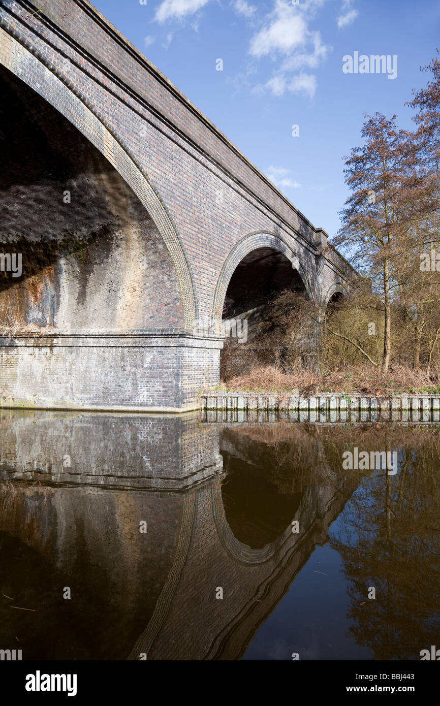 Grand Union Canal with arched railway bridge, Denham Country Park, Buckinghamshire, England - Stock Image