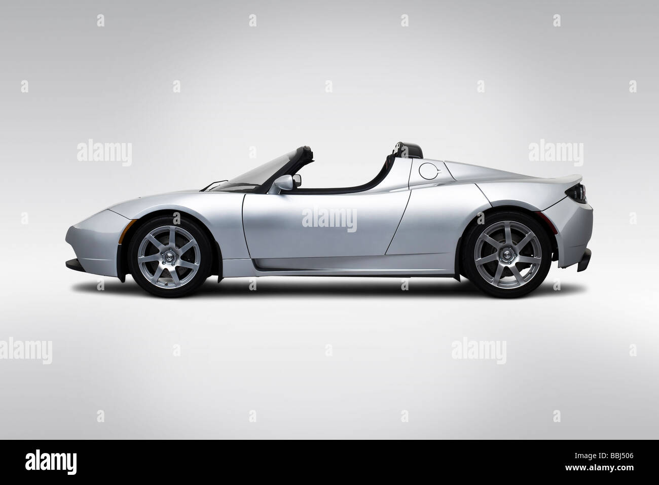 2009 Tesla Roadster in Silver - Drivers Side Profile - Stock Image