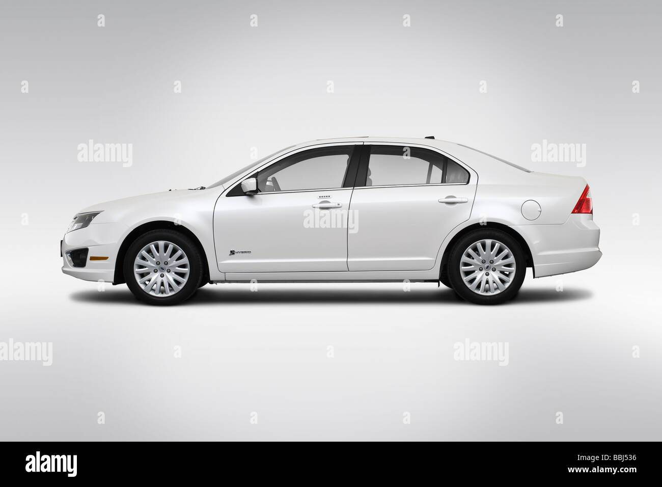 2010 Ford Fusion Hybrid in White - Drivers Side Profile Stock Photo