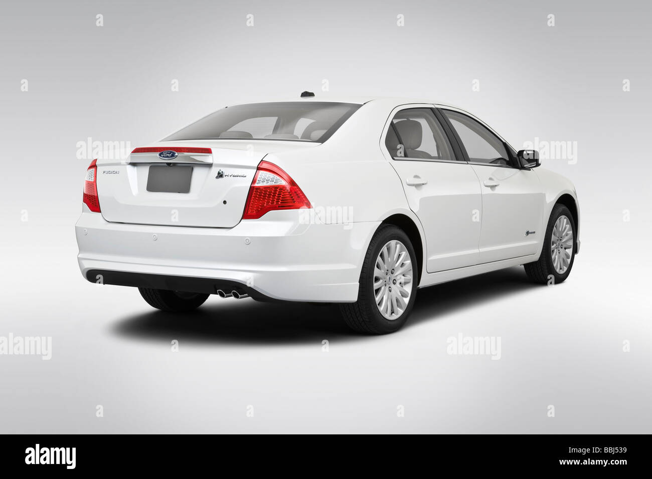2010 Ford Fusion Hybrid in White - Rear angle view - Stock Image