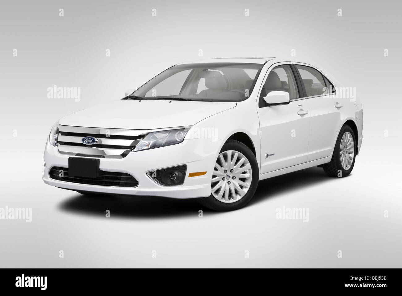 2010 Ford Fusion Hybrid in White - Front angle view - Stock Image