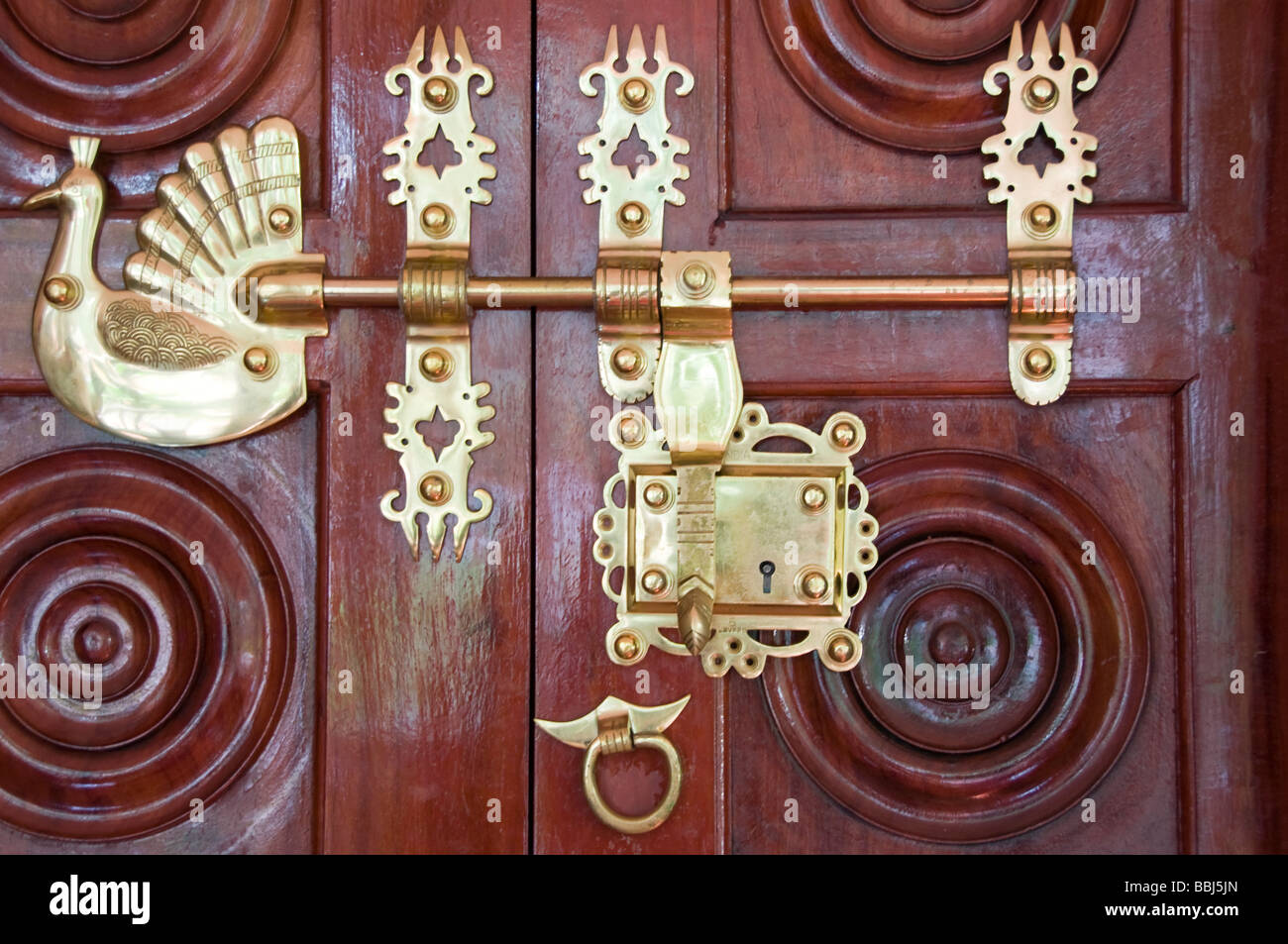 Antique Traditional Brass Door Latch And Lock On Wooden Doors, Kerala India    Stock Image