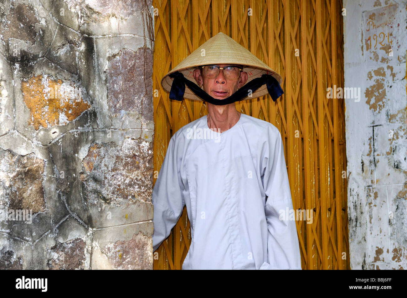 Buddhist monk wearing big glasses and typical Vietnamese hat made of reeds 53bc2ad54a6