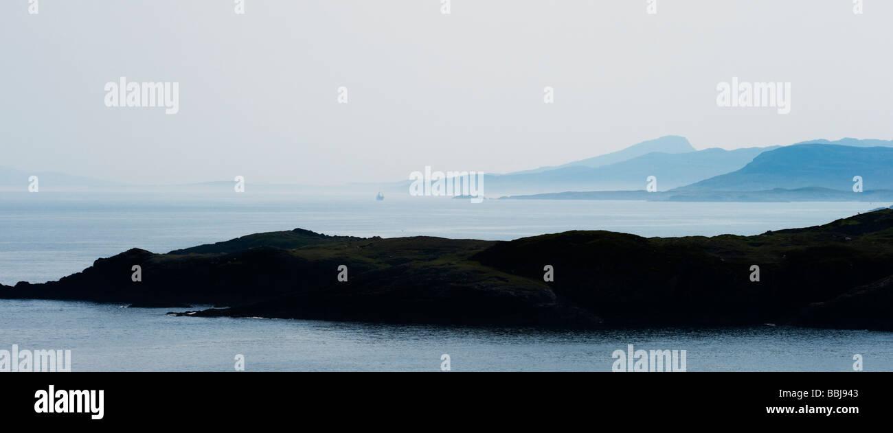 Hazy blue eastern coastline and sea, South harris, Isle of Harris, Outer hebrides, Scotland. Panoramic - Stock Image