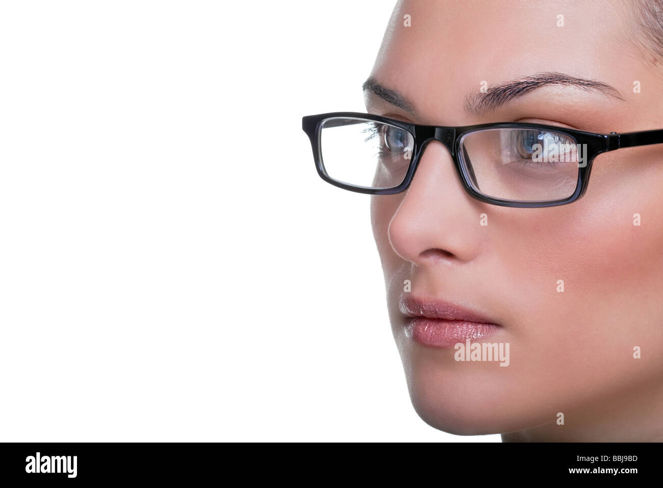 Close up face portrait of a woman wearing glasses - Stock Image