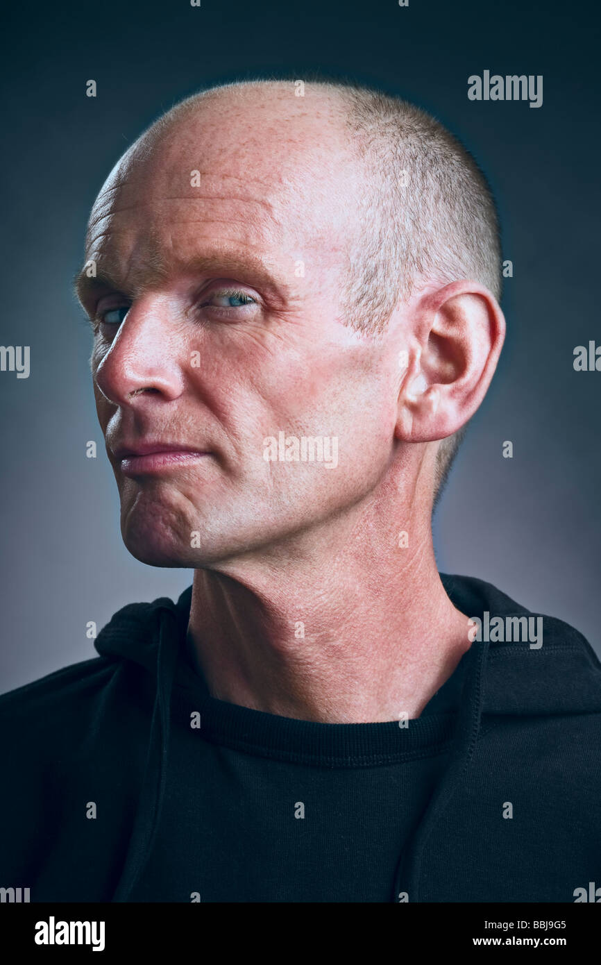 Portrait of sinister man in black clothing - Stock Image