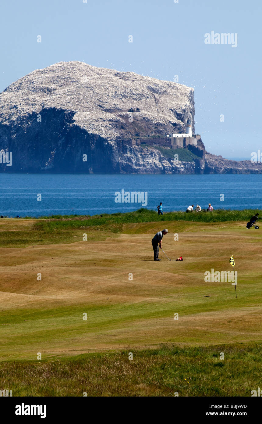Golfers on Glen Golf Course with Bass Rock in background, North Berwick East Lothian Scotland UK Europe - Stock Image