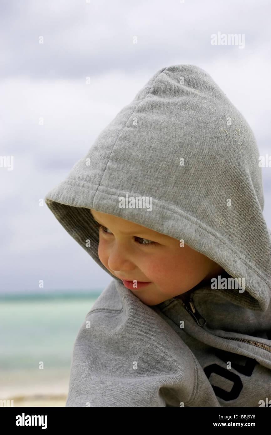 Boy in hoodie on the beach, Camagüey, Cuba - Stock Image