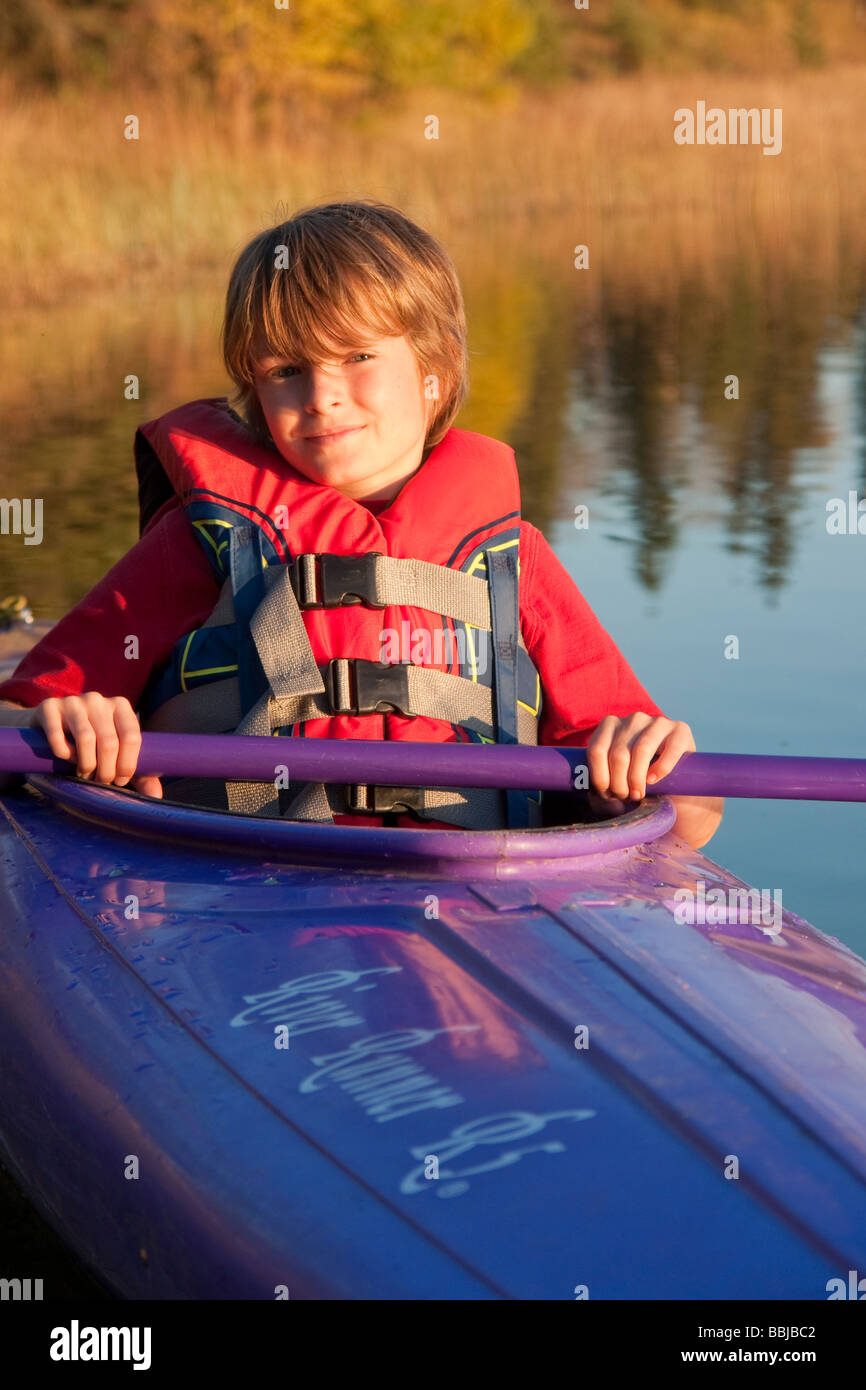 10 year old boy in kayak, Lake Katherine, Riding Mountain National Park, Manitoba - Stock Image