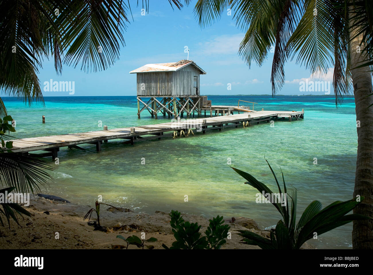 Tobacco Caye Jetty - Stock Image