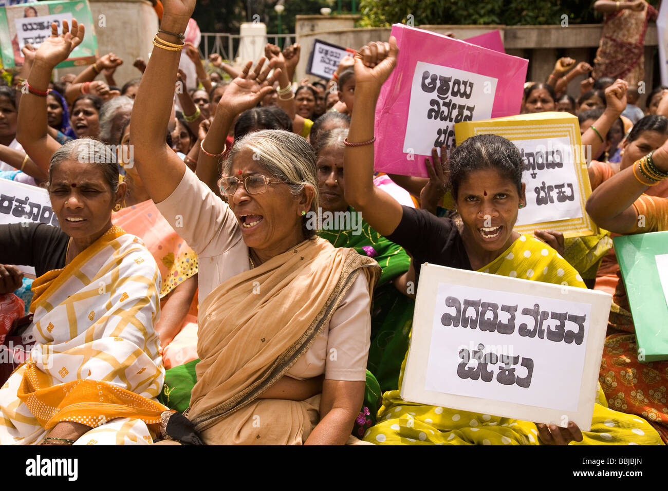 Women hold placards during a protest in Bangalore, India. The women are demostrating for women's and dalit (untouchable) - Stock Image