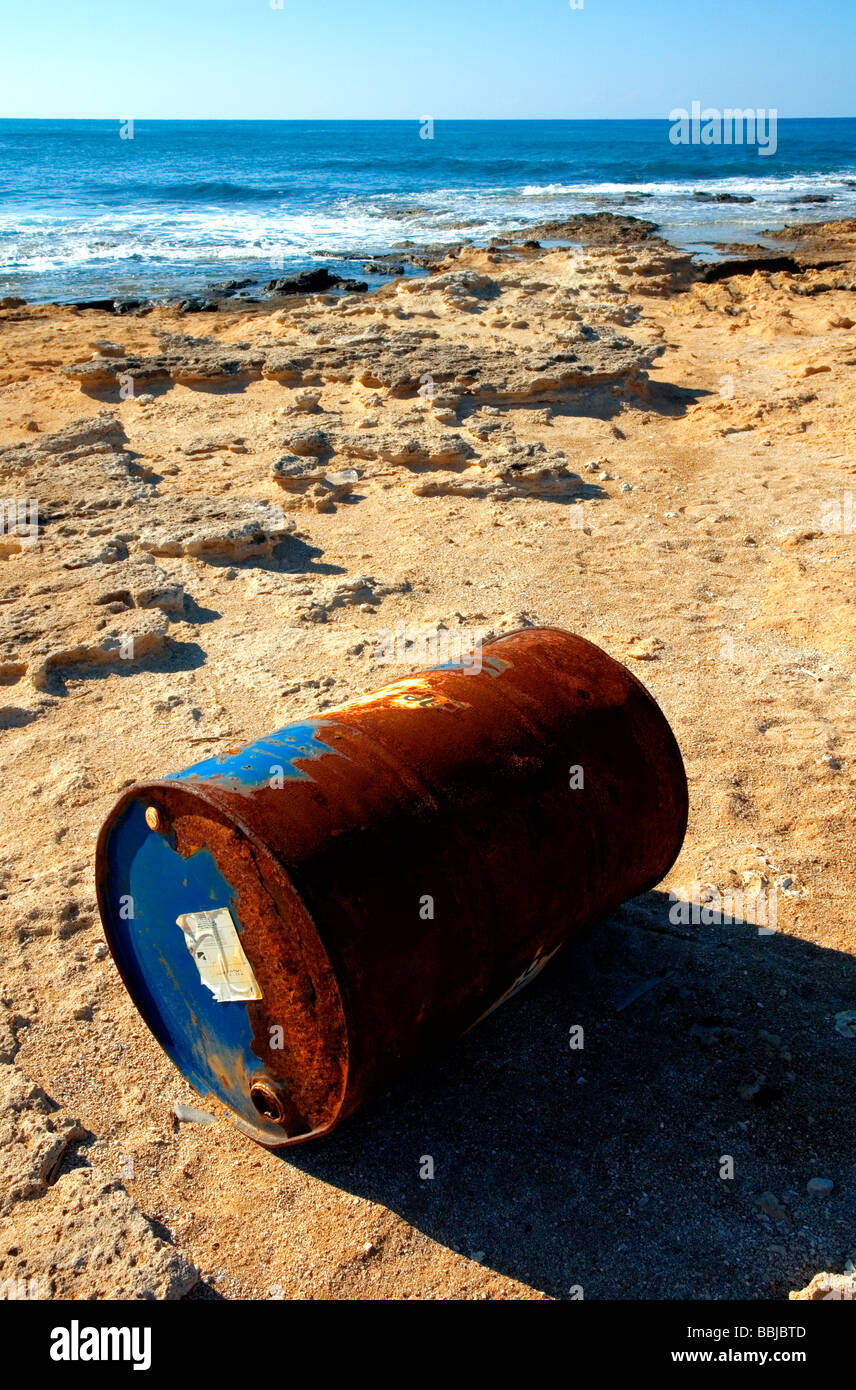 OIL DRUM ON A BEACH - Stock Image