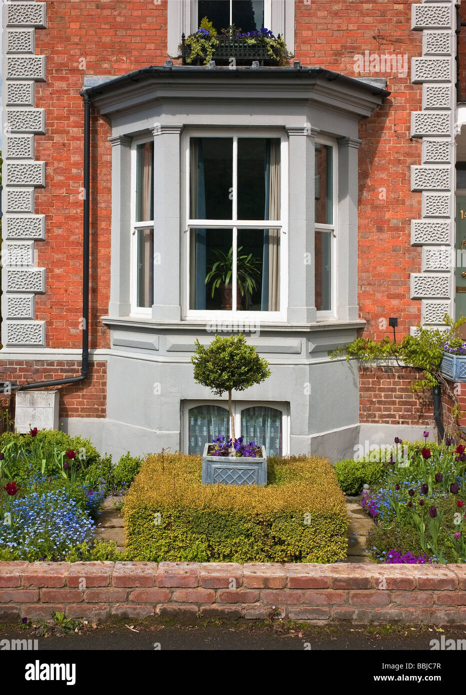 Victorian Bay Window And Small Front Garden Seen From Street In