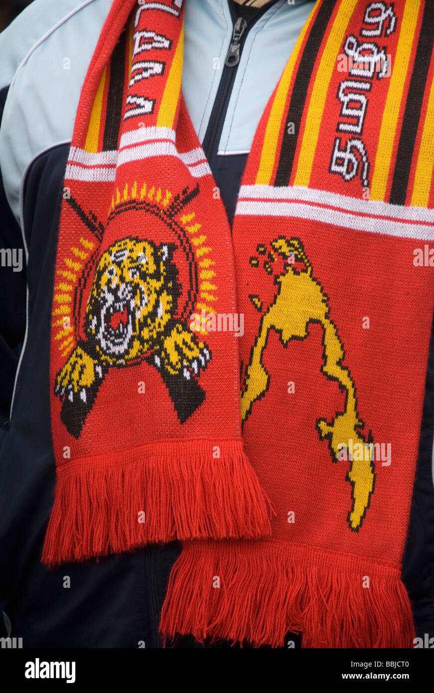 Demonstration by Tamils Man wearing a scarf with Tamil Tiger symbol and map of Tamil Eelam the free state they would Stock Photo