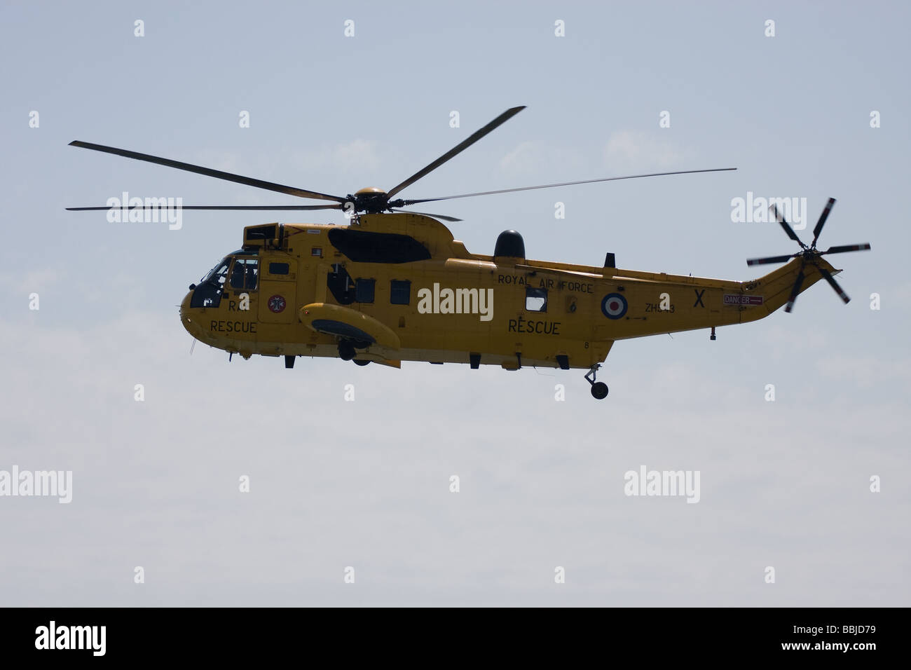raf yellow search rescue helicopter flying blades southend airshow england uk europe - Stock Image